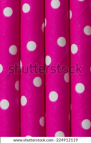 Colorful Pink white dot paper straw background in vertical