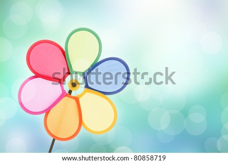 colorful pinwheel toy against bokeh background