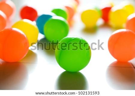 colorful plastic balls on children's playground.