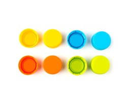 Colorful Plastic bottle caps on white background. selective focus