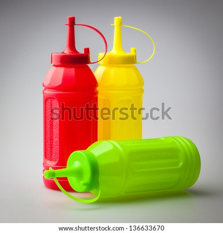 Colorful plastic bottle for sauce containing