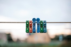 Colorful plastic clothespins on the hangers, clothespins on the hangers rope for wash clothes