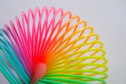 colorful plastic coil on white background, plastic toy spring
