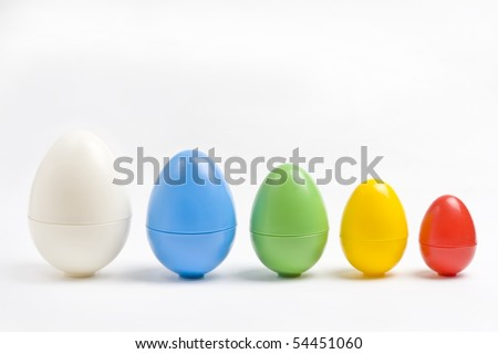 Colorful plastic eggs in various sizes