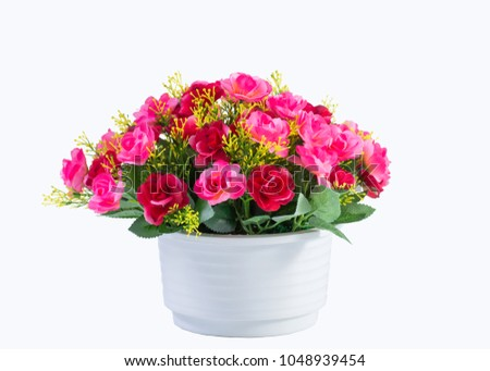Colorful plastic flower in white vase on white background. #1048939454