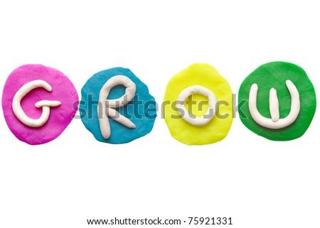 Colorful plasticine alphabet form word GROW