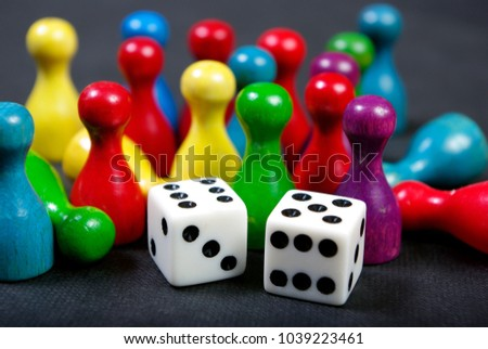 colorful play figures with dice on board #1039223461