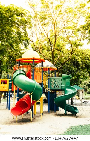 Colorful playground equipment for kid and baby in the public park.