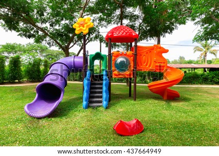 Colorful playground fun in park. #437664949