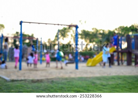 Colorful playground with children and parents in park (blur background)