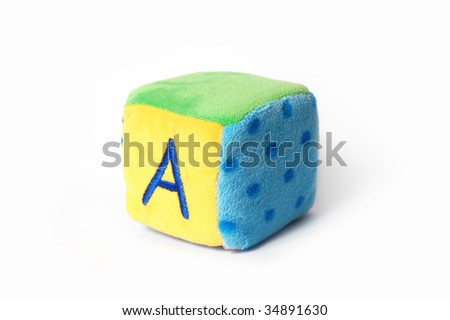 "Colorful plush cube toy with written letter ""A"" on it, isolated on white surface"