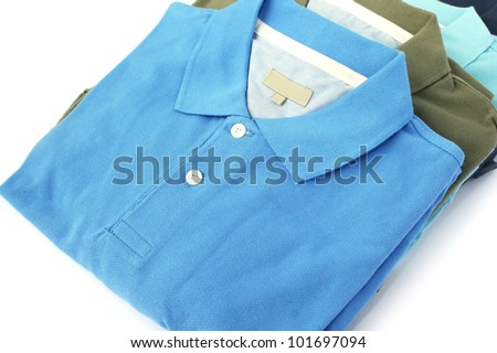 Colorful polo shirts isolated on white background.
