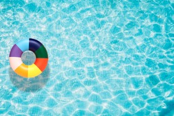 Colorful pool float, ring floating in a refreshing blue swimming pool