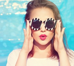 Colorful portrait of young attractive woman wearing sunglasses. Summer beauty  concept