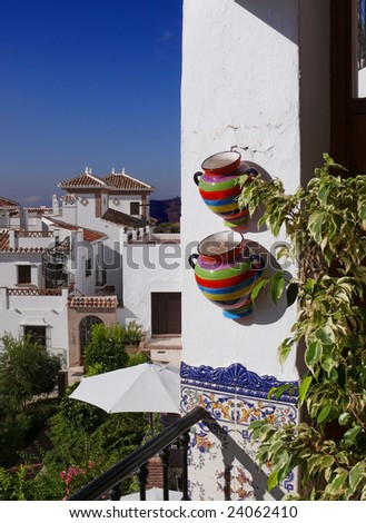Colorful pots on the Mediterranean balcony. Postcard from Andalusia.