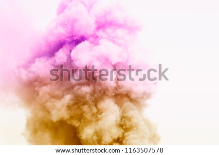 Photo of  Colorful powder explosion.Colored cloud. Colorful dust explode.Paint Holi.Bomb smoke background,Smoke caused by explosions
