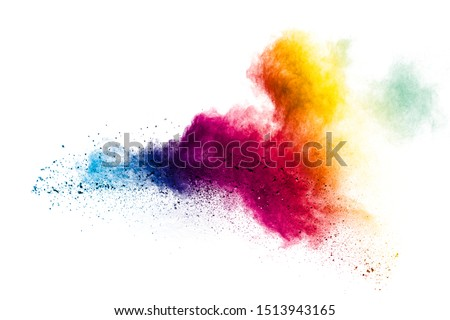 Photo of  Colorful powder explosion on white background.Pastel color dust particle splashing.