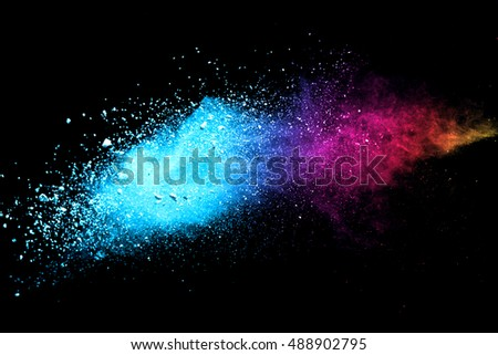 Colorful powder/particles fly after being exploded against black background - Shutterstock ID 488902795