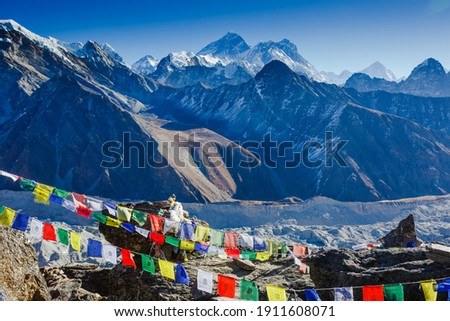 Colorful prayer flags on the Everest Base Camp trek in Himalayas, Nepal. View of Mount Everest and Mountain Peak Nuptse