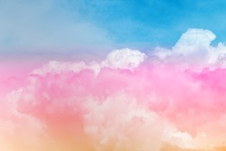 Colorful puffy fluffy pink & yellow white clouds & cloudscape on beautiful sunny blue sky horizon in tropical summer or spring sunlight & sun light rays at daylight sunshine day, copy free space