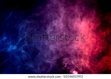 Colorful  purple and blue smoke clouds on dark background - Shutterstock ID 1014601993