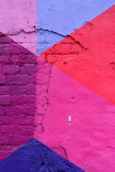 Colorful (purple, blue and pink) brick wall as background, texture