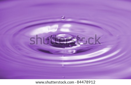Colorful  purple water drop and splash