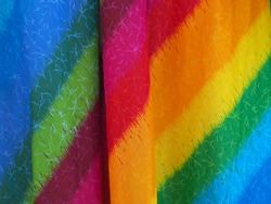 Colorful rainbow fabric abstract background .