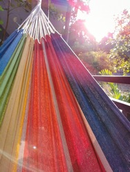 colorful rainbow hammock in a sunny day
