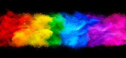 colorful rainbow holi paint color powder explosion garland banner isolated on dark black wide panorama background. peace rgb beautiful party concept