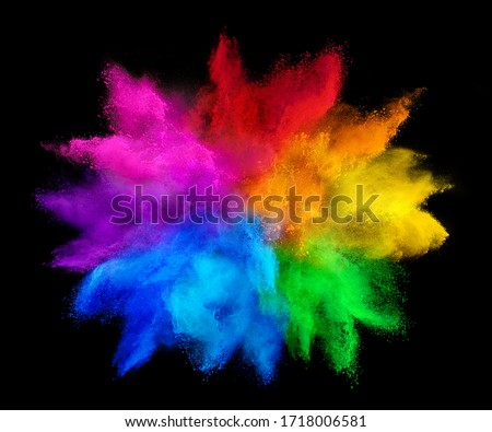 Photo of  colorful rainbow holi paint color powder explosion isolated on dark black background. peace rgb gaming beautiful party festival concept