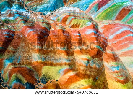 Colorful Rainbow Mountains in Zhangye National Geopark; aerial view on sandstone hills and mountain chains covered with amazing pattern due to deposition of minerals, Gangsu, China, May 2017