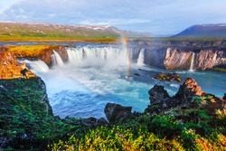 Colorful rainbow on Godafoss waterfall on Skjalfandafljot river, Iceland