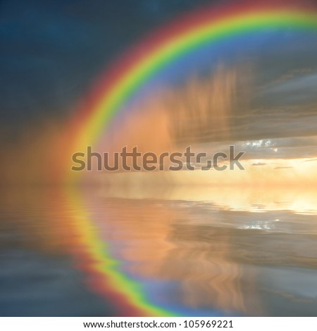 Colorful rainbow over water, thunderstorm with rain on background