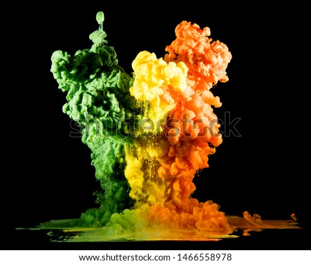 Colorful rainbow paint drops from above mixing in water. Ink swirling underwater #1466558978