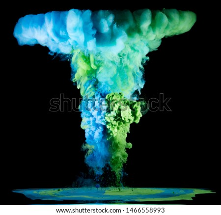 Colorful rainbow paint drops from above mixing in water. Ink swirling underwater #1466558993