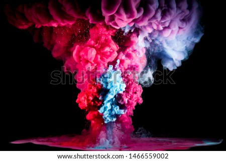Colorful rainbow paint drops from above mixing in water. Ink swirling underwater #1466559002