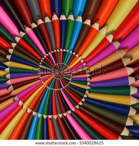 Colorful rainbow sharpen pencils spiral background pattern fractal. Pencils background pattern. School pencils rainbow spiral fractal repetitive distorted background. Pencils rainbow conceptual image