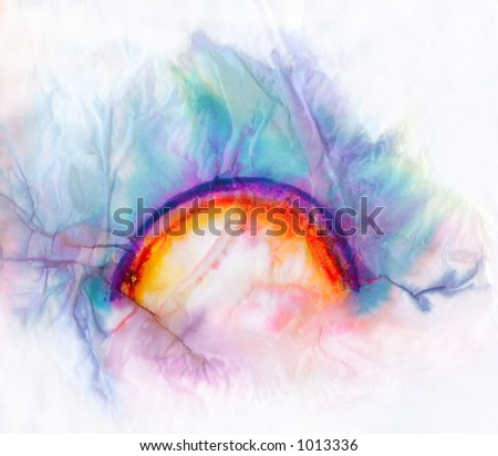 colorful rainbow stain on soaked creased paper