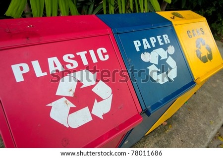 Colorful recycle bins for plastic, paper and metal waste for environment conservation.
