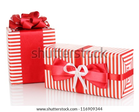Colorful red gifts isolated on white