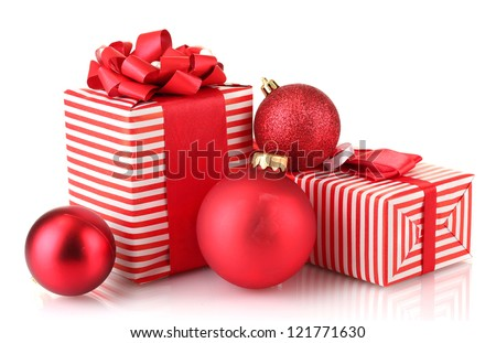 Colorful red gifts with Christmas balls isolated on white