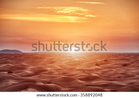Colorful red sunset over desert