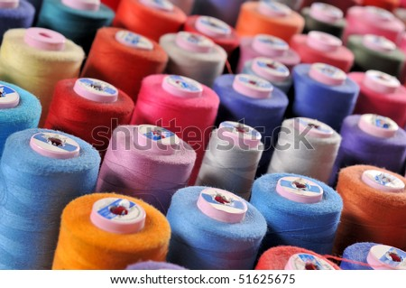 Colorful reels of threads background - A series of TAILOR related images.