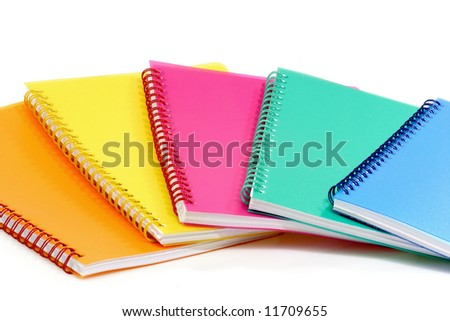 Colorful ring bound books that are isolated on white Background.