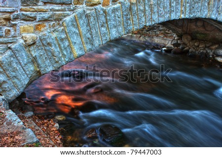 Colorful river bridge and smooth water in hdr.