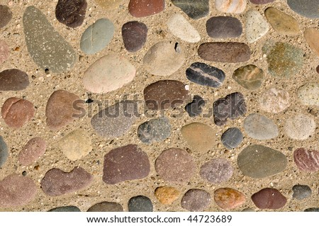 Colorful Rocks and Stones in Sand Background