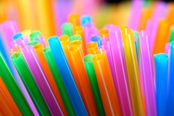 Colorful rod of straw with mixed color background