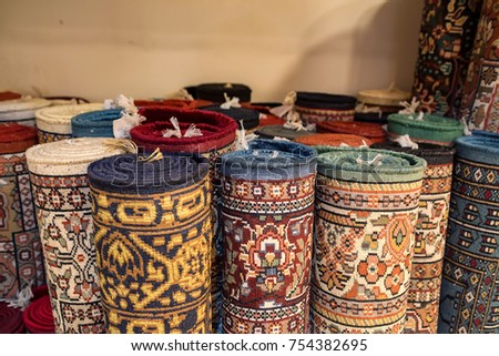 Colorful rolled carpets in oriental marketplace #754382695