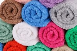 Colorful rolled towels stack closeup picture.